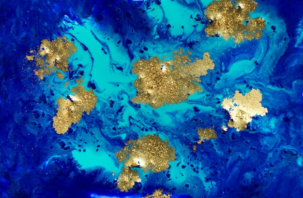 Fondo abstracto azul y oro jaspeado líquido