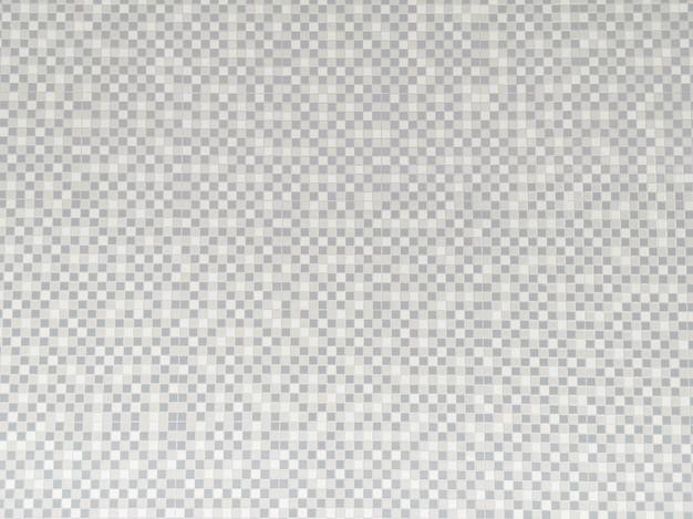 Fondo abstracto de azulejos de cerámica gris y blanco