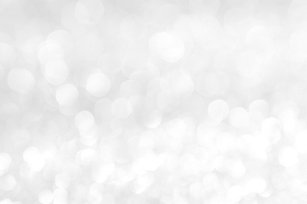 Fondo abstracto blanco luces de plata en bokeh de navidad