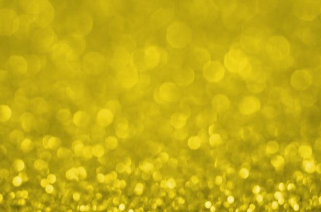 Fondo abstracto bokeh. iluminando el color pantone del año 2021.