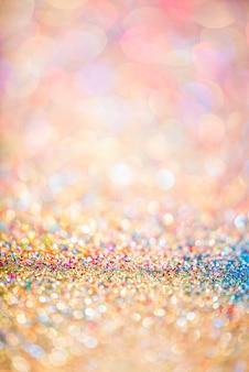 Fondo abstracto borroso colorido del bokeh del brillo del oro para el aniversario