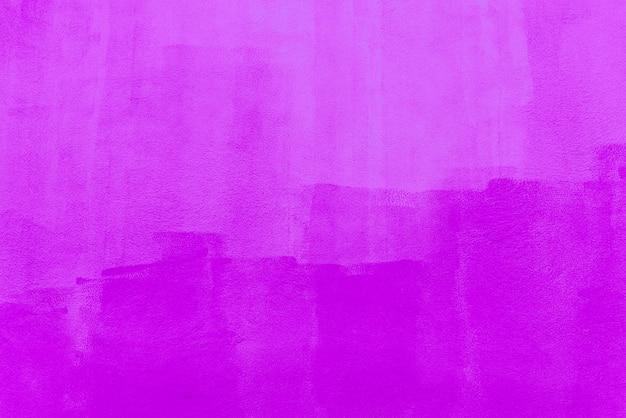 Fondo abstracto de color rosa pintado en muro de hormigón