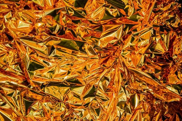 Fondo abstracto festivo de textura de brillo dorado