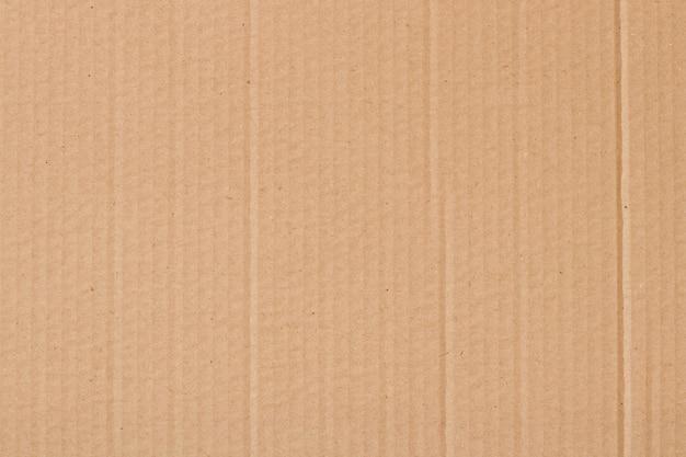 Fondo abstracto de la hoja de cartón marrón, textura de la caja de papel reciclado en la superficie vintage antigua para el trabajo de arte de diseño.