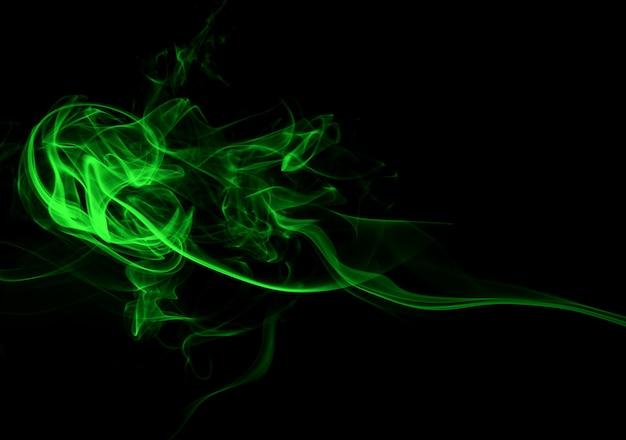 Fondo abstracto de humo verde. concepto de oscuridad