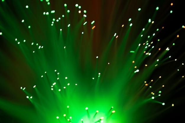 Fondo abstracto de luces de fibra óptica verde
