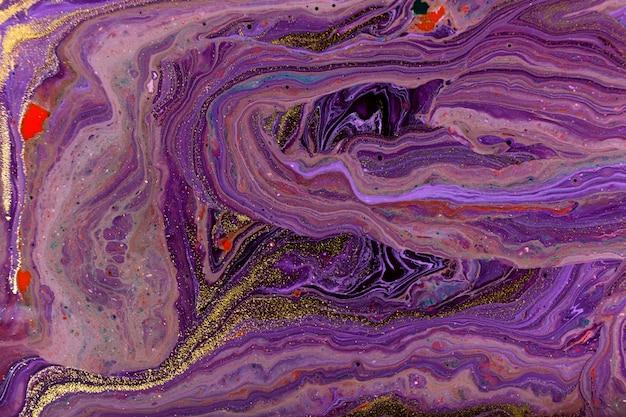 Fondo abstracto de mármol violeta. textura de tintas mixtas con brillo dorado.