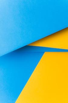 Fondo abstracto de papel amarillo y azul en blanco