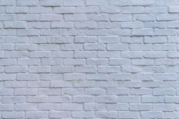Fondo abstracto de pared de piedra de ladrillos blancos y agrietados