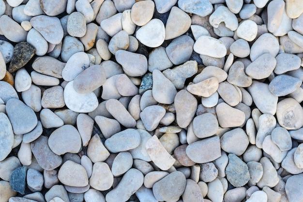 Fondo abstracto con piedras redondas del mar