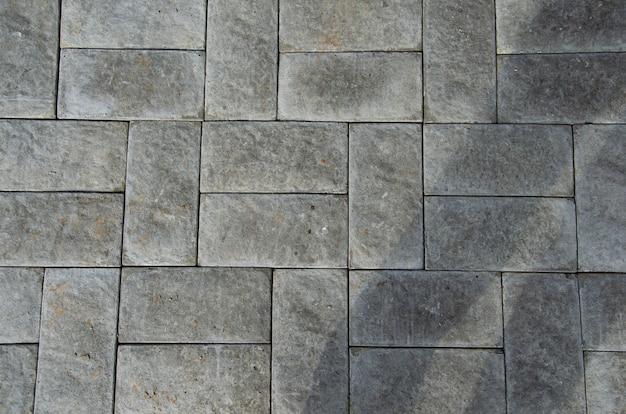 Fondo abstracto. primer plano antiguo de pavimento de adoquines. ciudad