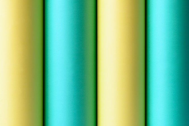Fondo abstracto de rollos de papel azul y amarillo