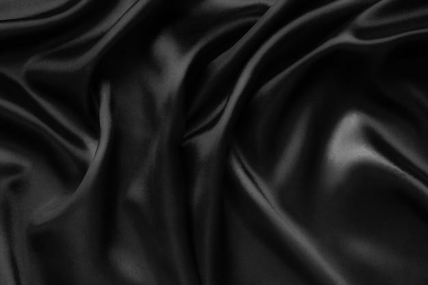 Fondo abstracto de tela de lujo u onda líquida o pliegues ondulados