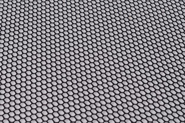 Fondo abstracto tela de malla negra con celdas pequeñas, textura