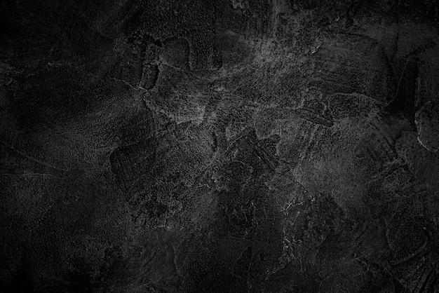Fondo abstracto de la textura concreta negra con grunge y rasguñado en tono oscuro.