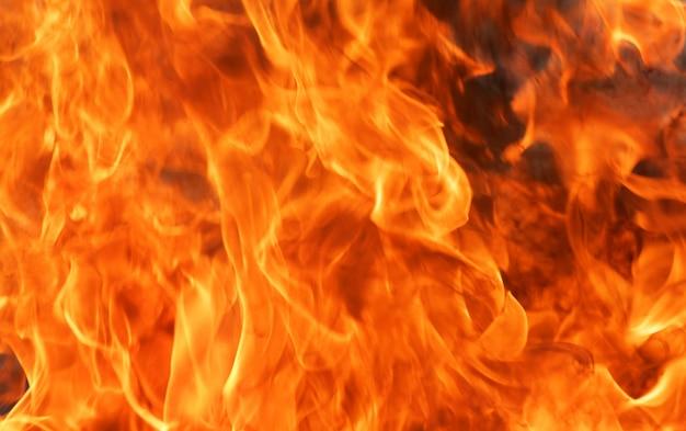 Fondo abstracto de la textura de la llama del fuego del resplandor.