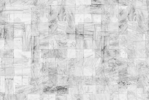 Fondo abstracto de la textura y del modelo de mármol blancos en la pared.