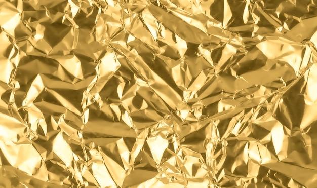 Fondo abstracto de textura de papel arrugado de oro