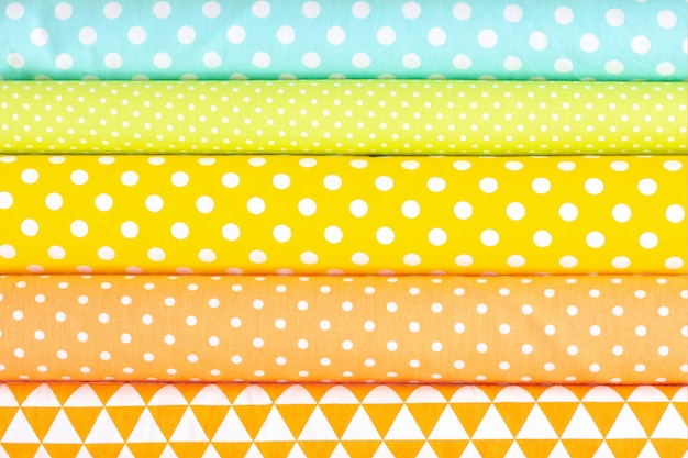 Fondo abstracto, textura de la tela de tonos claros de algodón. colores rosa, naranja, amarillo, turquesa