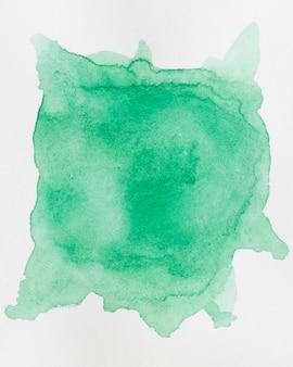 Fondo de acuarela abstracta con una salpicadura de sombra esmeralda de pintura de acuarela