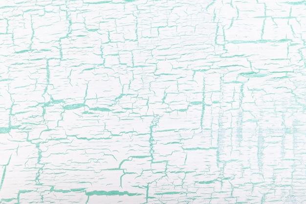 Fondo agrietado pintado blanco y verde abstracto.