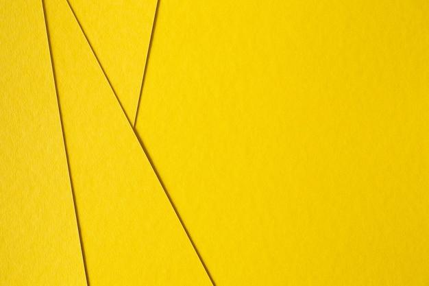 Fondo amarillo abstracto de la cartulina