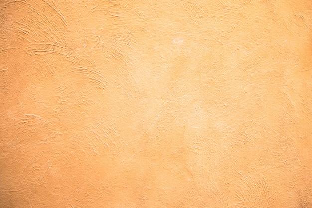 Fondo amarillo abstracto de la textura de la pared del cemento