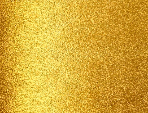 Fondo amarillo brillante de la textura del metall del oro de la hoja