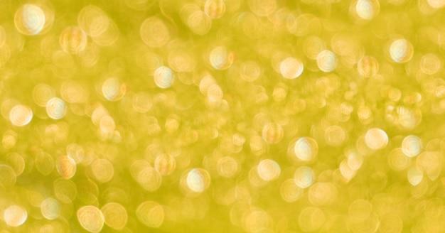 Fondo amarillo cálido borroso abstracto con resplandor del sol