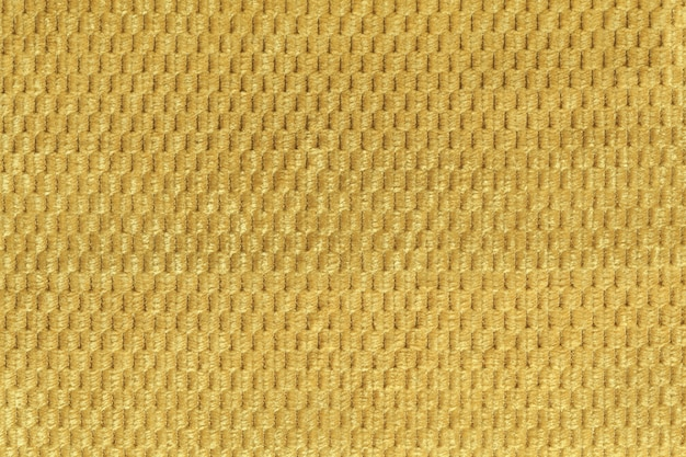 Fondo amarillo del cierre suave de la tela lanosa para arriba. textura de macro textil
