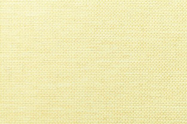 Fondo amarillo claro de la tela de ensacado tejida densa, primer. estructura de la macro textil.