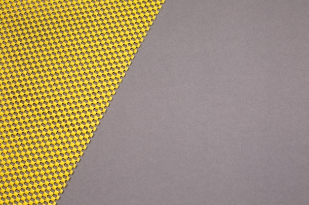 Fondo amarillo y gris moderno abstracto. demostrando colores del año 2021. vista superior.