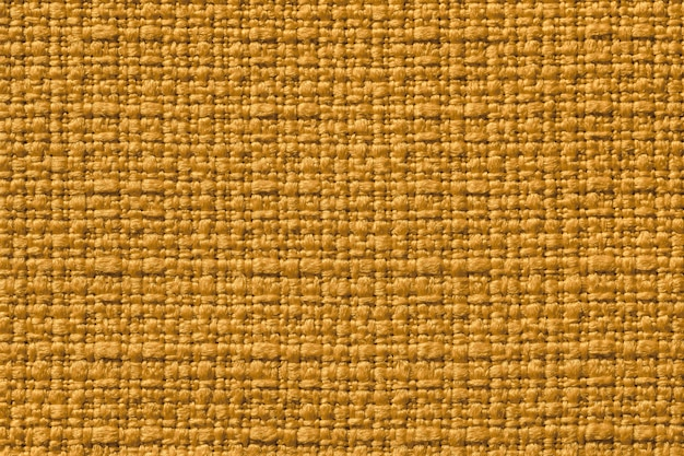 Fondo amarillo oscuro de un material textil.