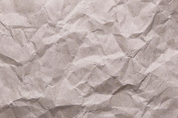 Fondo arrugado de la textura del papel del vintage para el contexto de la superficie del diseño en su trabajo.