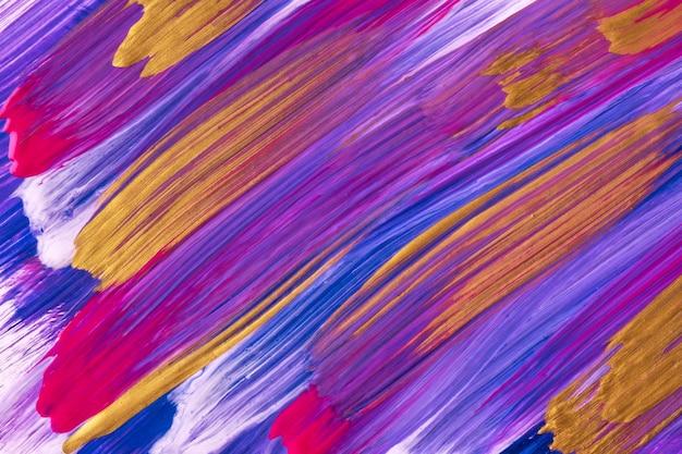 Fondo de arte abstracto colores morados, dorados y azules oscuros. pintura de acuarela con trazos violetas y salpicaduras. obra acrílica sobre papel con patrón de pincelada. telón de fondo de textura.