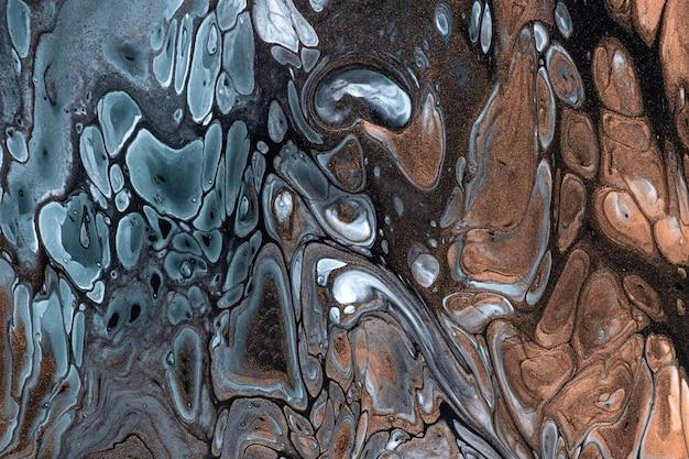 Fondo de arte fluido abstracto colores azul y bronce.