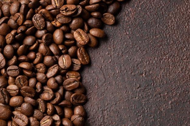 Fondo asado primer de los granos de café.