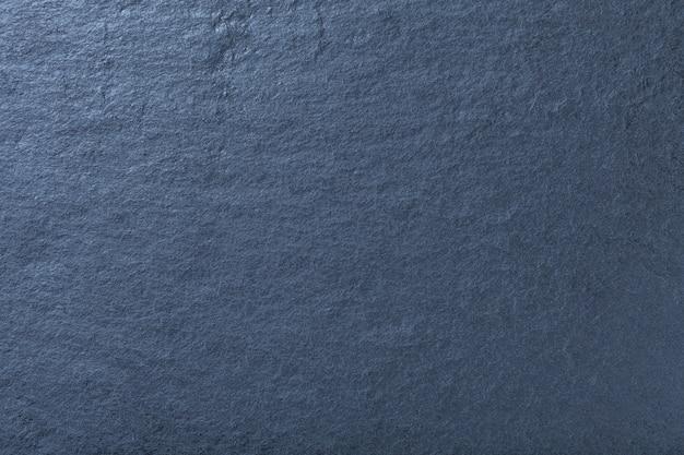 Fondo azul marino de pizarra natural, textura de piedra.