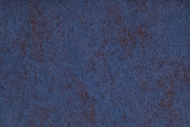 Fondo azul marino de tela de fieltro.