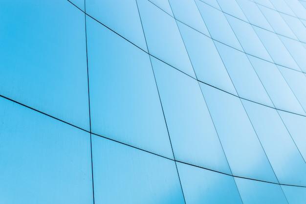 Fondo azul, negocio de construcción con las líneas en las paredes.