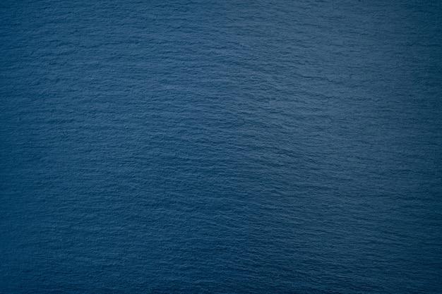 Fondo azul oscuro, color de tendencia, textura de piedra natural
