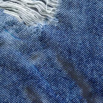 Fondo azul de la textura de la mezclilla del dril de algodón. jeans textura de tela rasgada