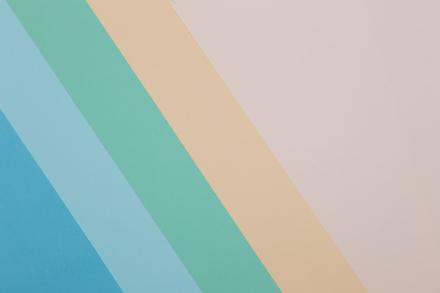 Fondo azul, verde, amarillo, el papel de color se divide geométricamente en zonas