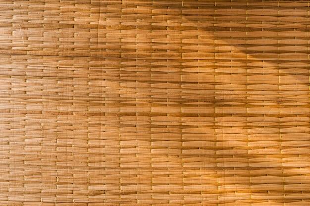 Fondo de bambú de la textura de la artesanía del detalle que teje.