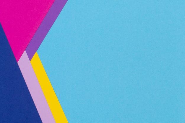 Fondo de banner de papel geométrico abstracto con fondo de textura de papel de color azul claro, amarillo, rosa, púrpura de moda