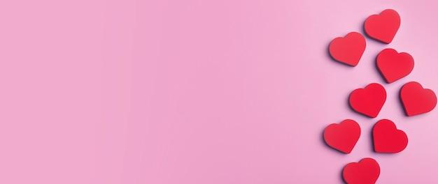 Fondo de banner de san valentín. corazones rojos sobre un fondo rosa mínimo. concepto de amor, romance y corazones.