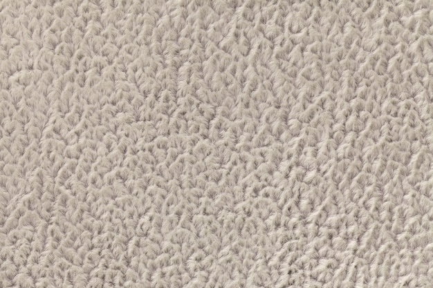 Fondo beige de tela suave y vellosa. textura de primer plano textil