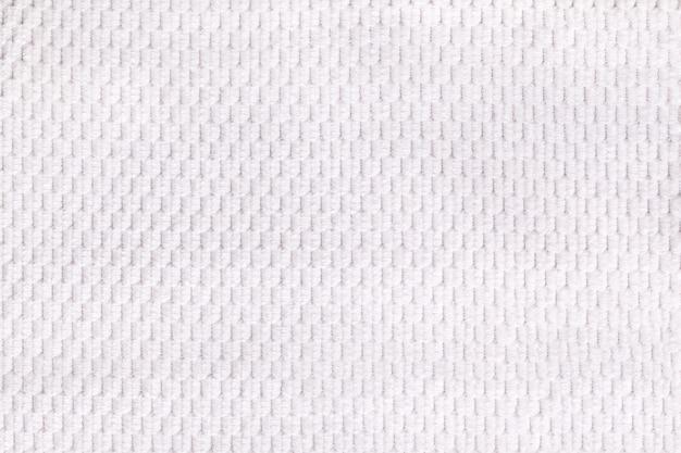Fondo blanco del primer suave de la tela lanosa. textura de macro textil