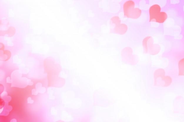 Fondo blanco rosado del corazón del bokeh