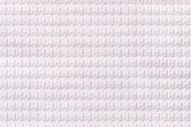 Fondo blanco de suave tejido lanoso de cerca, textura de textiles